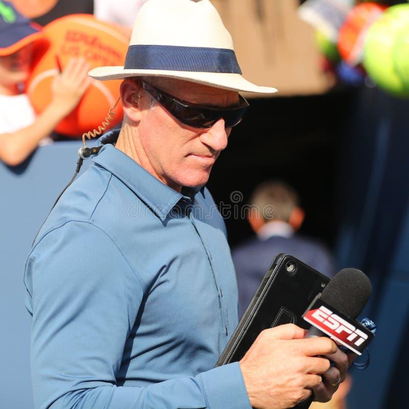 ESPN analyst Brad Gilbert comments tennis match at US Open 2016. NEW YORK - SEPTEMBER 3, 2016: ESPN analyst Brad Gilbert comments tennis match at US Open 2016 at stock images