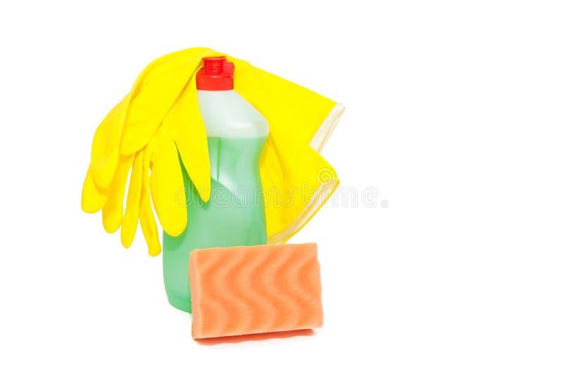 Esponja con el líquido y los guantes de lavado del plato foto de archivo