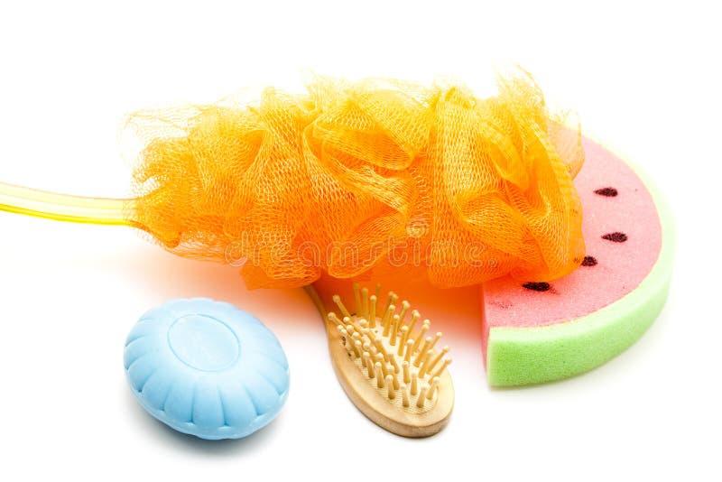 Esponja líquida com a escova da esponja e da massagem do banho fotografia de stock royalty free