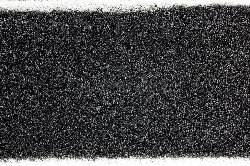 Esponja preta com textura branca da lona fotografia de stock