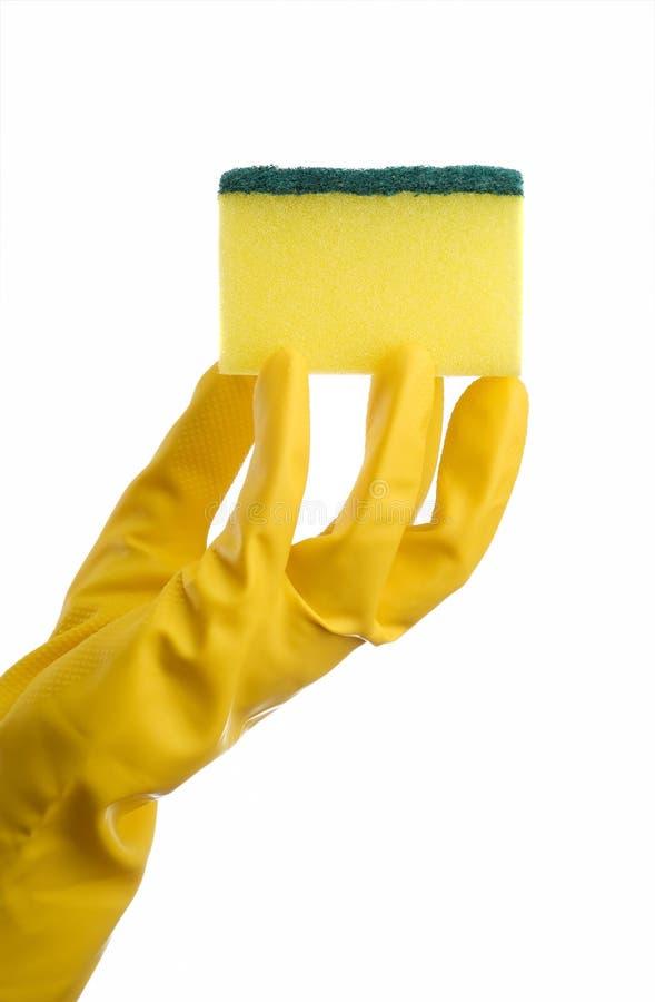 Esponja y mano amarillas de la limpieza imagen de archivo libre de regalías