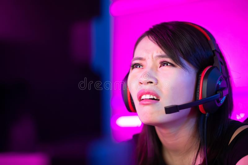 Esport gamer girl feel angry. Young asian esport gamer girl feel angry while playing in Online Video Game because of internet is down royalty free stock photography