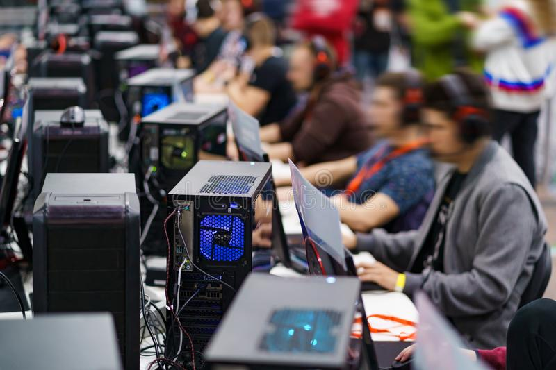 ESport gaming tournament. Lots of desktop computers and professional gamers royalty free stock image