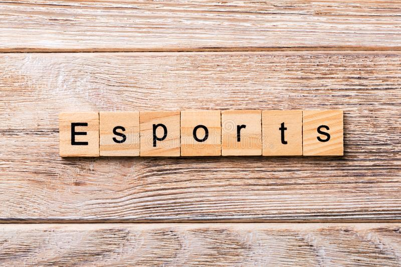 Esport word written on wood block. Esport text on wooden table for your desing, concept.  royalty free stock photography