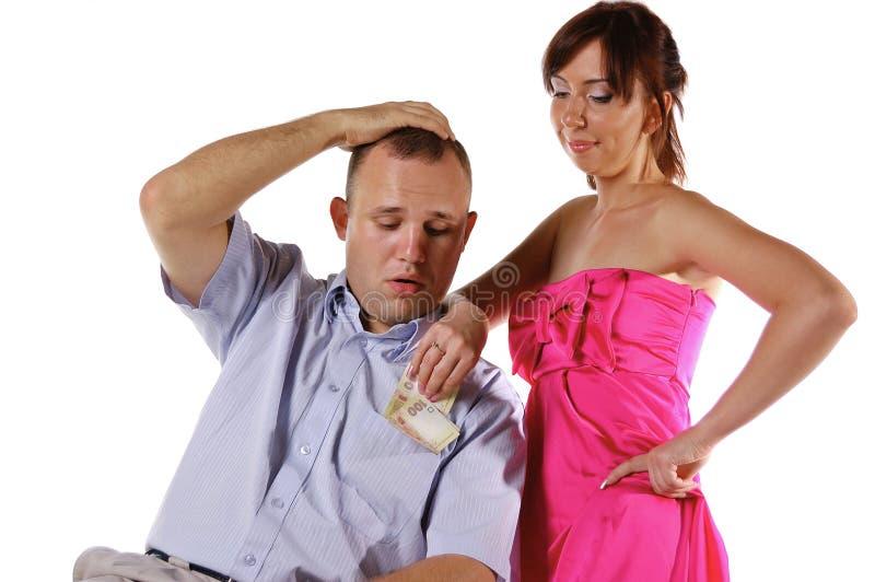 A esposa leva embora o dinheiro do marido imagens de stock royalty free
