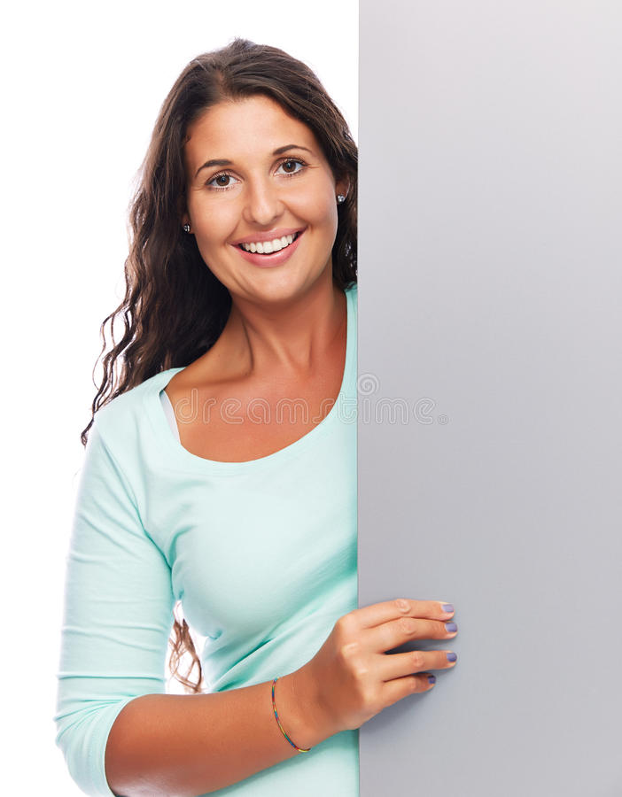 Espreitando a mulher vazia de sorriso do sinal fotografia de stock