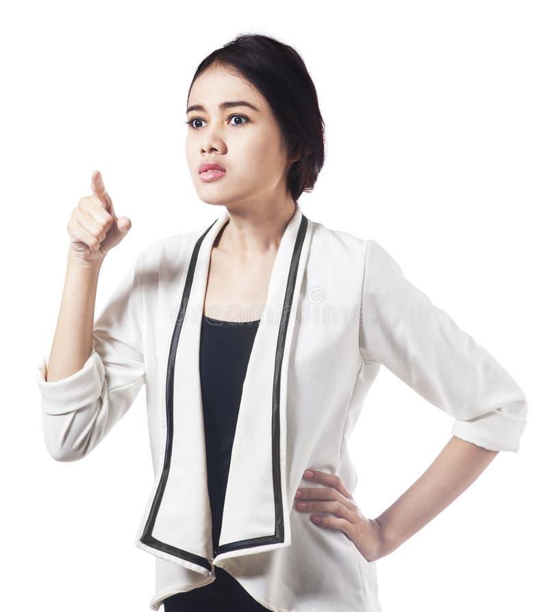 Espressione comandone della donna di affari asiatica fotografia stock libera da diritti