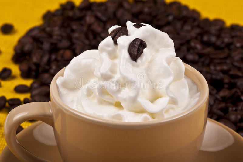 Espresso. With cream ands coffee beans at the back stock photography