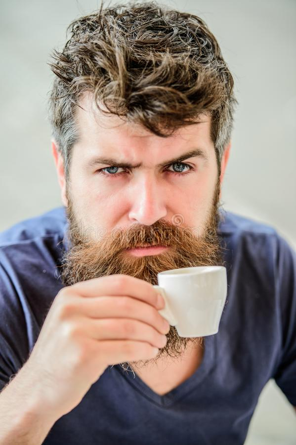 Espresso arabica only. Coffee break concept. Guy relaxing espresso. Enjoy hot drink. Hipster drinking fresh brewed. Coffee. Man with beard and mustache and stock images