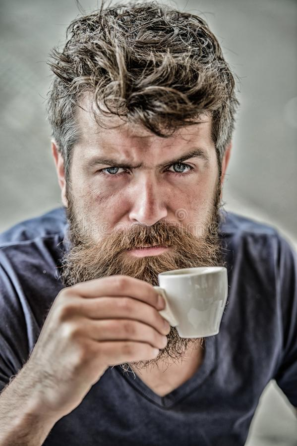 Espresso arabica only. Coffee break concept. Guy relaxing espresso. Enjoy hot drink. Hipster drinking fresh brewed stock image