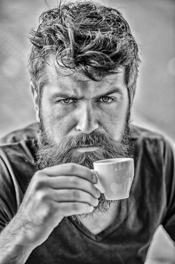 Espresso arabica only. Coffee break concept. Guy relaxing espresso. Enjoy hot drink. Hipster drinking fresh brewed. Coffee. Man with beard and mustache and royalty free stock photo