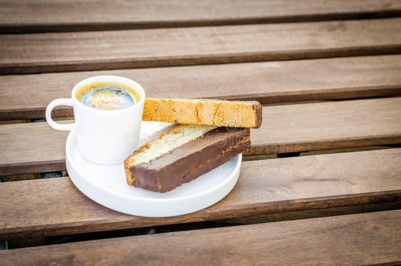Espresso with biscotti stock photos
