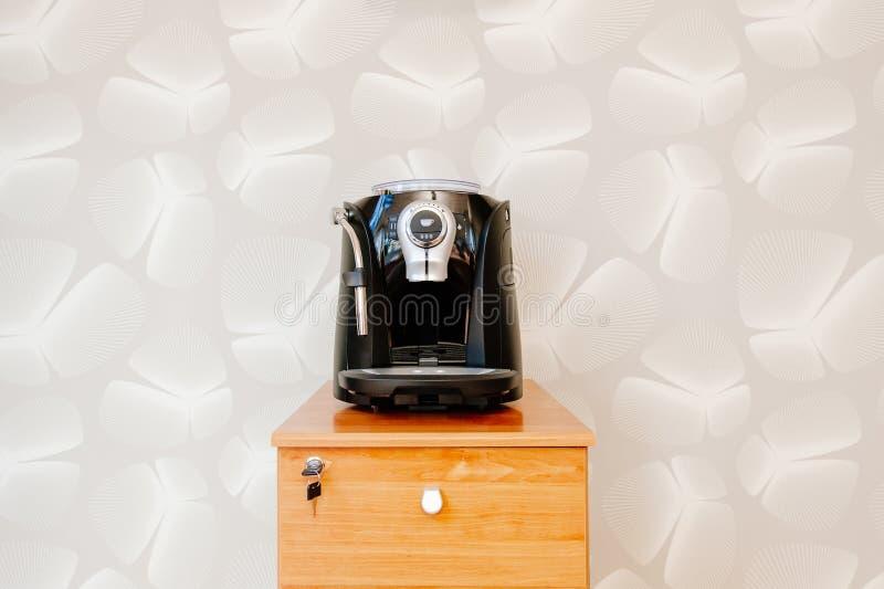 Espresso, cappuccino and americano coffee maker machine royalty free stock photos