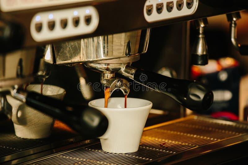Espresso coffe cup. Professional coffeee machiene make espresso royalty free stock photography
