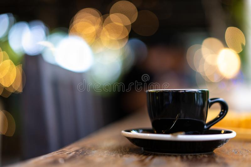 Cup of espresso coffee on wooden table with nice stock photo