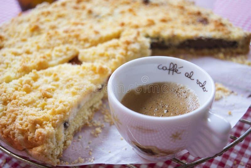 Espresso coffee and chocolate crumble tart. Espresso coffee and crumble tart at breakfast stock image