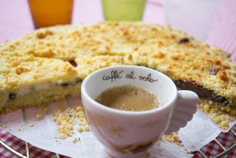 Espresso coffee and chocolate crumble tart. Espresso coffee and crumble tart at breakfast royalty free stock photo