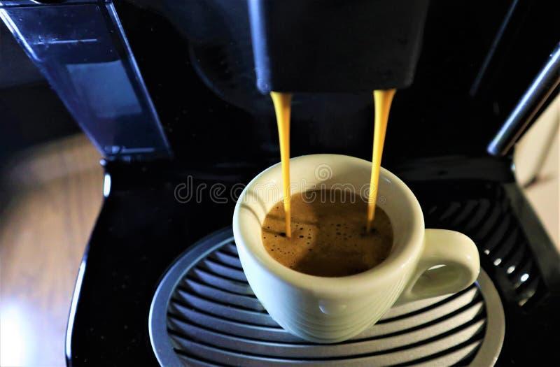 Espresso coffee from coffee machine royalty free stock photos