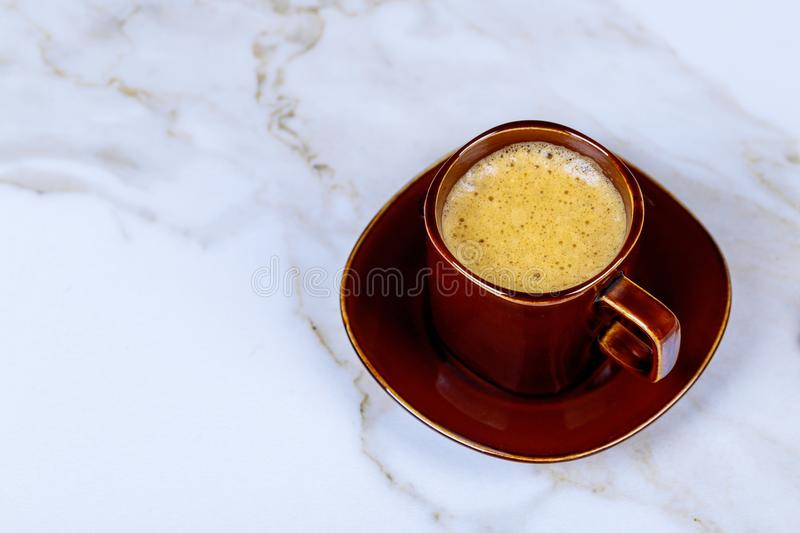 Espresso coffee cup on white marble table. Espresso brown coffee cup on white marble table royalty free stock image