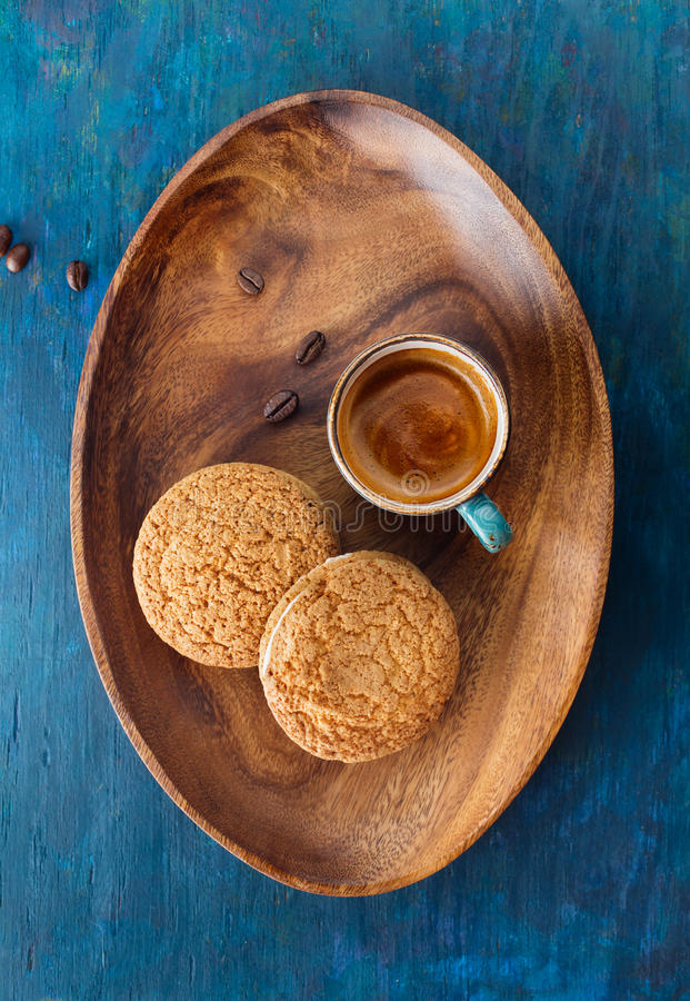 Espresso. Coffee in cup on a wooden tray and cookies . Top view stock image