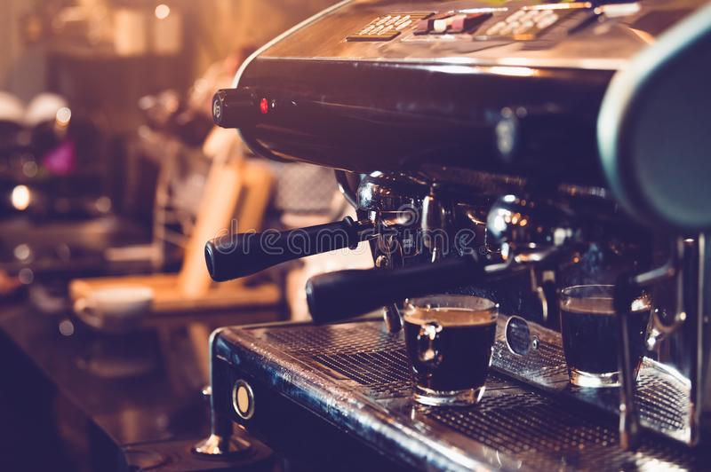 Espresso coffee maker machine working in pub and restaurant bar background. Business food and drinks concept.  stock photo
