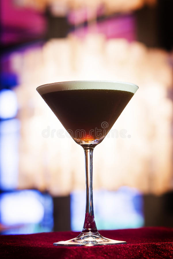 Espresso coffee Martini cocktail in trendy bar. Espresso coffee Martini cocktail drink in trendy bar interior royalty free stock photography