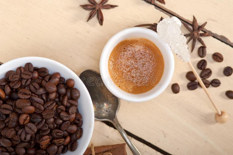 Espresso coffee with sugar and spice. Espresso coffee over white wood rustic table with sugar and spice royalty free stock image