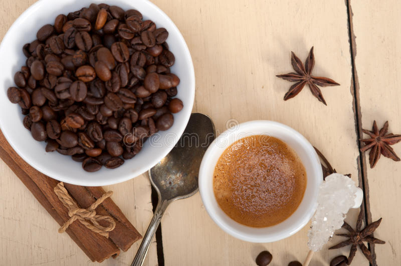 Espresso coffee with sugar and spice. Espresso coffee over white wood rustic table with sugar and spice stock photos