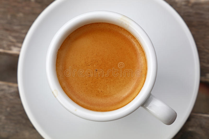 Espresso coffee in white cup close up top view stock photography