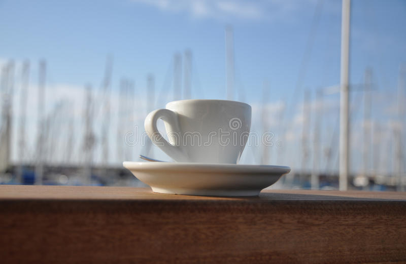 Espresso cup on bar by the port royalty free stock photography