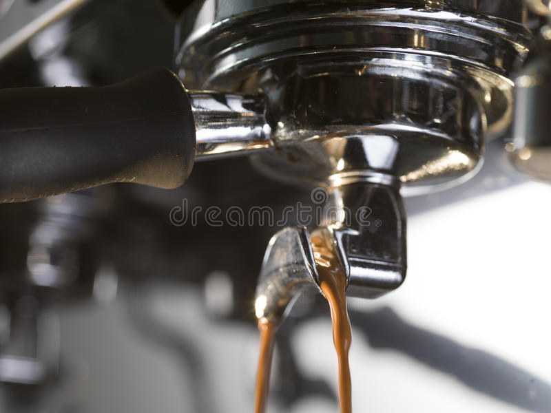 Espresso extraction with a proffessional coffee machine stock photo