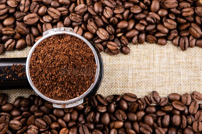 Espresso filter with coffee beans on burlap with copy space stock photos