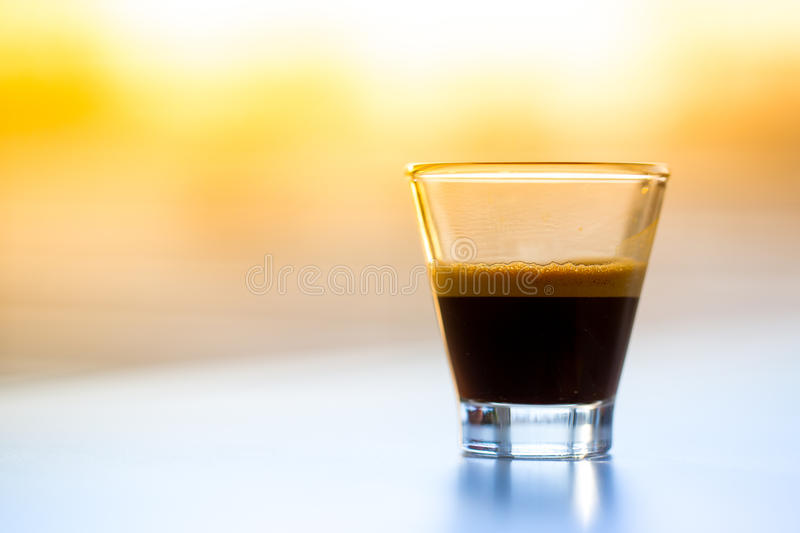 Espresso in glass royalty free stock photos