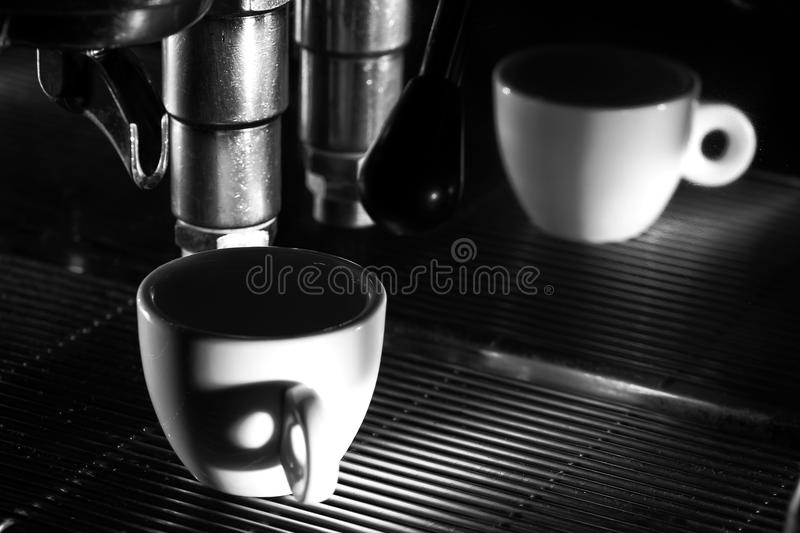 Espresso machine brewing a coffee. Black and white photo royalty free stock image