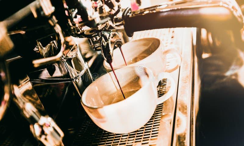 Espresso machine brewing a coffee. Coffee pouring into glasses in coffee shop, espresso pouring from coffee machine royalty free stock image