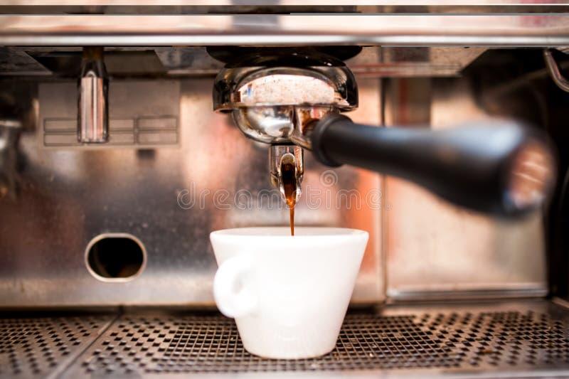 Espresso machine pouring coffee in pub, bar, restaurant. Close-up of espresso machine pouring coffee in pub, bar, restaurant royalty free stock images