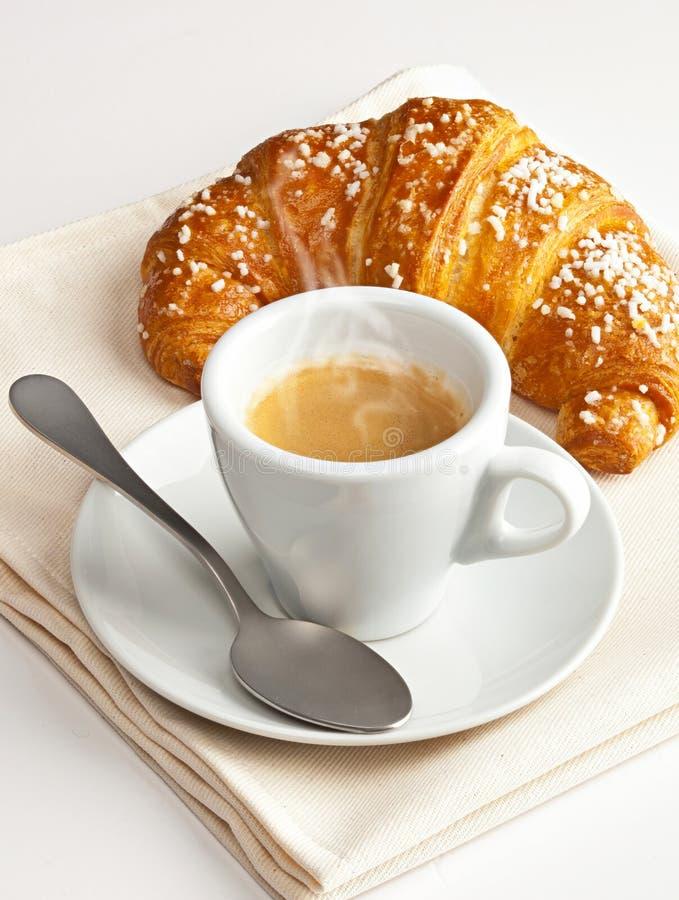 Espresso met croissant stock fotografie
