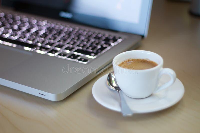 Espresso next to Notebook stock photo