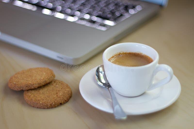 Espresso next to Notebook stock image