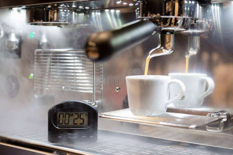 Espresso perfect shot,timer for making coffee to get a good and complete coffee shot. At coffee shop royalty free stock images