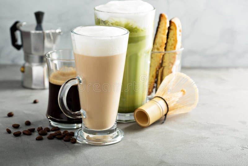 Espresso, regular coffee and matcha latte. On light background stock image
