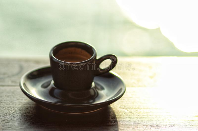 espresso on wooden table in the morning stock photography