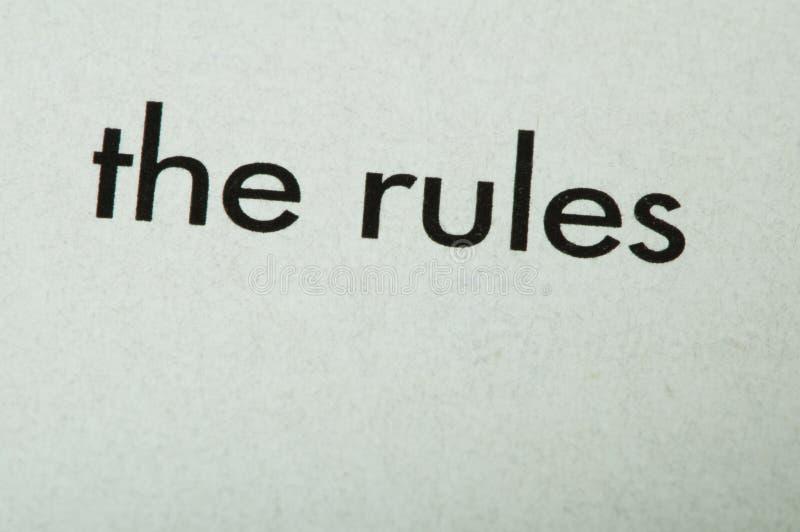 Esprima le regole immagine stock