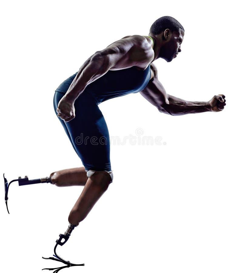 Esprinteres perjudicados de los corredores del hombre con el silhouett de la prótesis de las piernas imagen de archivo libre de regalías