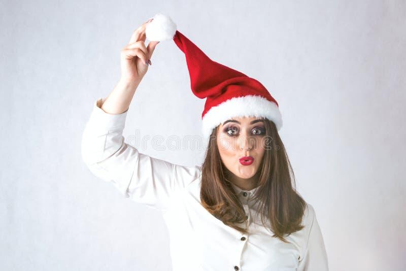 Esprit de fille épaisse de Noël en modèle XXL, wom de chapeau du père noël photos stock