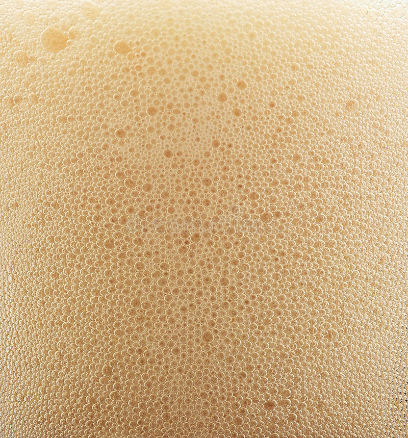 Espuma da cerveja do close up foto de stock royalty free