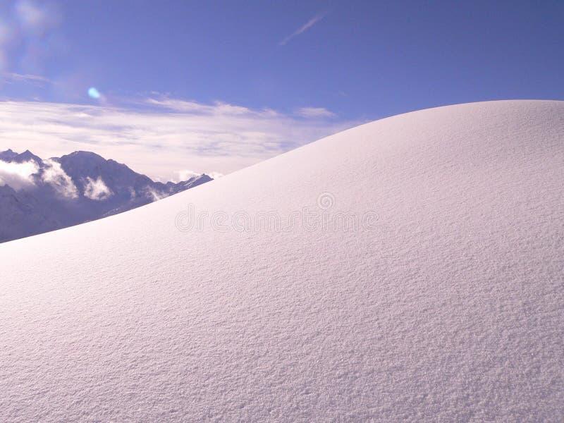Esquí más verbier del esquí del polvo de la nieve foto de archivo