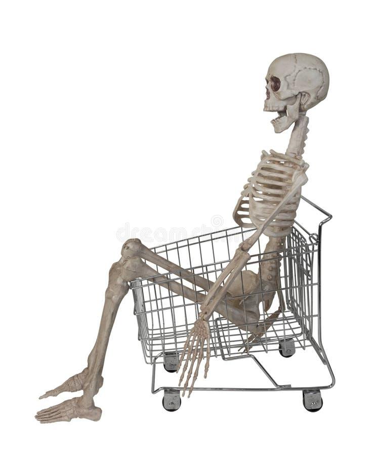 Esqueleto no carrinho de compras imagem de stock