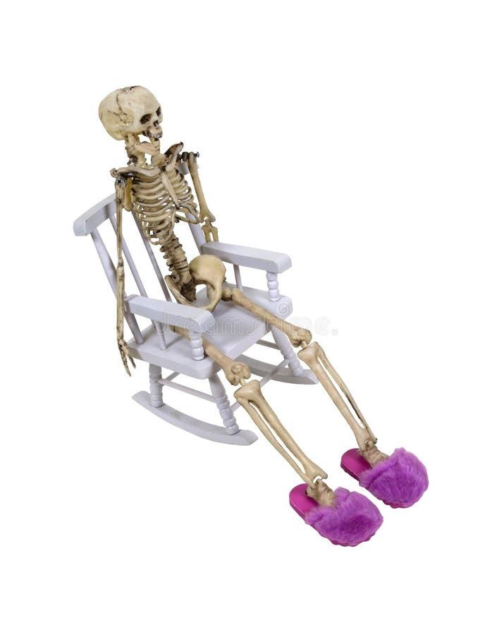 Esqueleto que relaxa com deslizadores fotografia de stock
