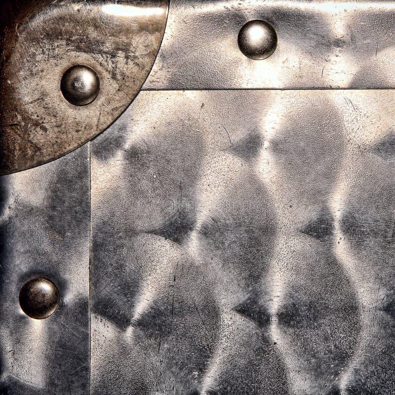Esquina de metal de hoja y fondo de Grunge de los remaches foto de archivo